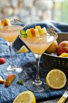 Peach Lemonade Martini-3 peaches, cut into chunky pieces 1 cup (8 fl.oz.) water 1-2 packets Stevia Powder (or natural sweetener of your choice to taste) 2 tbsp (30 ml) lemon juice 4 fl. oz. (120 ml) Le Citron Vodka a few dashes of Peach bitters Ice Peach and lemon slices for garnish Mint leaves for garnish