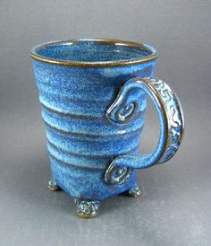 Hey, I found this really awesome Etsy listing at http://www.etsy.com/listing/68192645/textured-feet-mug-with-twisted-spiral