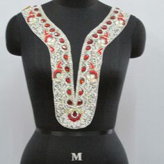 Intricate and delicate embroidery with red stones and gold threads. Also available as laces