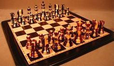 "Stunning chess set!  Inlaid Sheesham/Ebony Gloss double weighted chessmen: 17.25"" x 17.25"" Ebony/Birdseye Maple Board with 2"" squares, 3.75"" king with 1.6"" king base width"