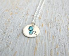 stamped wave necklace, beautifully simple with a blue-green accent bead to represent the water