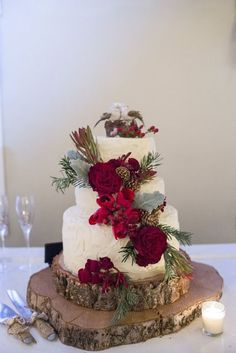 Holiday Christmas December Barn wedding in Independence Oregon. Just 10 min from Salem. Lovely winter wedding with burgundy, cranberry red, crimson, Christmas trees, twinkle lights. Long bridesmaid dresses. Christmas wedding cake with pine cones