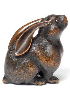 A fine wood netsuke of a female hare By Naito Toyomasa (1773-1856), Tanba, early 19th century