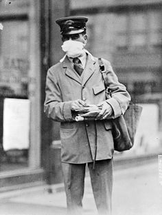 Letter carrier in New York wearing mask for protection against influenza. New York City, October 16, 1918.