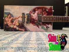 The Divine Diddley, custom made for a customer by SkinYourSkunk.com Guitar Skins.