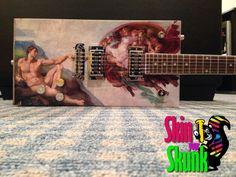 The Divine Diddley, custom made for a customer by SkinYourSkunk.com Guitar Skins.