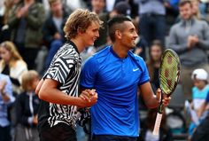 Alexander Zverev of Germany and Nick Kyrgios of Australia following their victory during the men's singles second-round match against Pablo Carreno Busta and David Marrero of Spain on day five of the 2016 French Open at Roland Garros on May 26, 2016 in Paris, France.