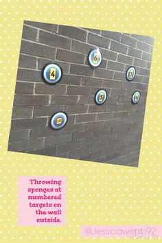 Throwing sponges at numbered targets on the walls outside. EYFS