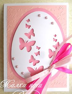 handmade Easter card by Donika  ... die cut egg with negative die cut butterflies ....sweet pinks ...