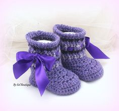 Ready to ship - This pair is 0-3 months, other sizes are available upon request  These crochet new born booties have been crochet in shades of purple, violet and lilac. The pair has been embellished with satin ribbon in a pretty purple tone. The pair has been crafted utilizing an acrylic-cotton blend of yarn. Very soft, non-itch, ideal for babys skin. The pair can be made in any color combination. They are the perfect gift for the mom-to-be. Just send me a message with your color…