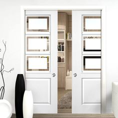 Double Pocket Andorra White sliding door system in three size widths with Etched Glass. #glazedpocketdoors #internalpocketdoors #pocketdoors