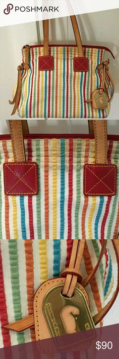Authentic Dooney & Bourke seersucker multi color Gorgeous bag in pre loved condition  Minor use Smoke free home Stripe pattern Inside pockets Zip top Great size Hard to find pattern Dooney & Bourke Bags Hobos