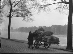 Man with push cart of the Hulp voor Onbehuisden shelter, loaded with old paper, along the river Amstel in Amsterdam. Ordinary Lives, Life Goes On, Old Paper, World War Ii, Old Photos, 1940s, To Go, Journalism, City