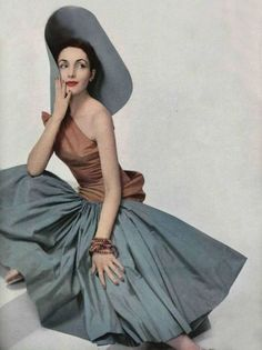 Model wearing a silk shantung evening dress by Madame Grès, 1952.
