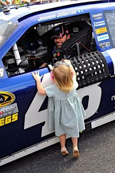 Jimmie Johnson, and daughter. Too cute.