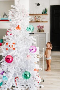 decks her halls in winter whites from her garland and wreath down to her duo of of Treetopia Frozen Fir trees. Her colorful Nutcracker decorating theme really pops against this winter scene. White Flocked Christmas Tree, Flocked Artificial Christmas Trees, Flocked Christmas Trees, Christmas Tree Wreath, Colorful Christmas Tree, Nutcracker Christmas, Green Christmas, Xmas, Lighted Tree Topper