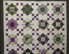 quatrefoil, My favorite pattern made with a favorite line of fabric.  Fresh Lilacs.  Tutorial can be found at Missouri Star Quilt Company