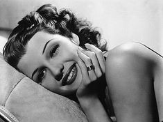 Rita Hayworth:  The young woman reminded Jake of an actress in an old movie his mother loved, Gilda. He'd seen some old footage of the same actress once, dancing for troops during World War II. The young woman on the dance floor looked just like that, a perfect pin-up girl for a lonely soldier.