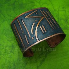 The PRIMAL Cuff, tribal art to wear! Since the beginning of time, weve loved to adorn ourselves. Primals etched designs into stone, wood and bones, and then adorned themselves with their tribal art. These etched artisan cuffs will add a primal touch to your little black dress, or