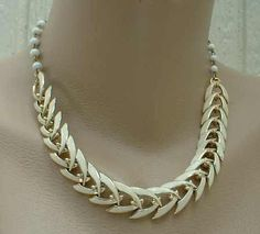 """This beautiful Coro necklace has 9"""" of beige enameled herringbone links and 8"""" of white round beads on a chain. The white beads add some nice whimsey to this otherwise sedate necklace! The necklace is"""