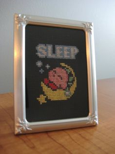 Kirby Sleep Cross Stitch  I asked my mom to make this for the baby's room.