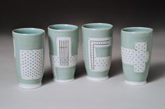NanCoffin - Four Party Tumblers  I like the principle of the various designs but everything pulled together by the glaze similarities.  Simple but interesting.