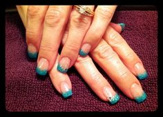Fun bright tipped french manicure.