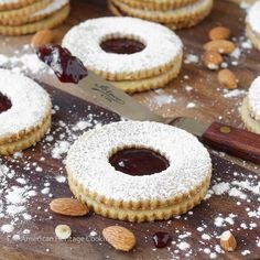 Traditional Raspberry Linzer Cookies are an Austrian rolled Christmas cookie that have raspberry preserves sandwiched between two almond cookies! Christmas Desserts, Christmas Baking, Macaroons Christmas, Italian Christmas, Linzer Tart, Cookie Recipes, Dessert Recipes, Raspberry Preserves, Almond Cookies