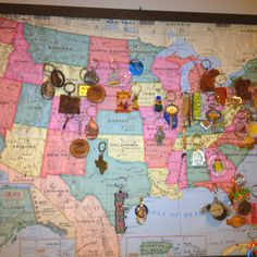 Key chains collected at travel destinations, pinned on a framed map!