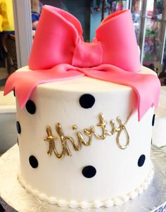 Classy 30th birthday cake with a pink bow on the top and polka dots - Cake #117.  #cutecake #polkadots