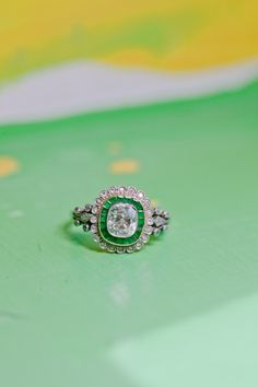 Gorgeous antique emerald wedding ring. Shown on stylemepretty.com.