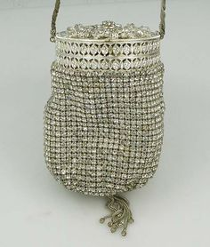 A vintage Walborg German rhinestone evening purse with tassel at the bottom. Circa 1950. Mirror and coin purse inside. Lined.