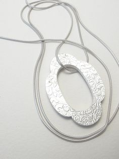 silver flora template necklace pendant on long chain by papermetal, $195.00