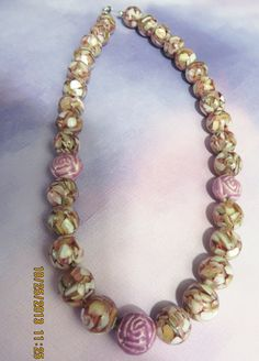 Mixed mother of pearl beads and glass rose beads