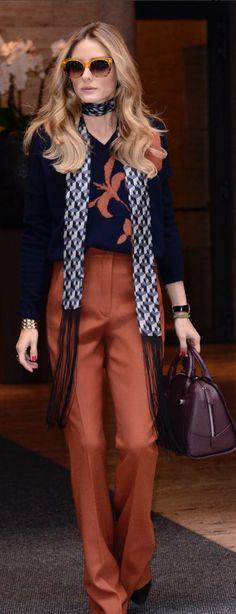Who made Olivia Palermo's brown pants, tan sunglasses, print scarf, handbag, and blue sweater?