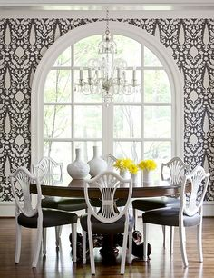patterned black and white walls with black and white chairs