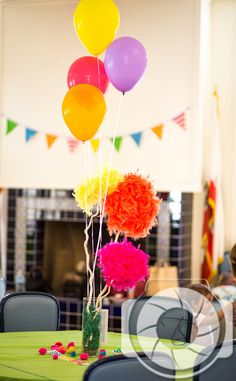 Lorax birthday party - truffula trees made from feather boas and styrofoam discs.