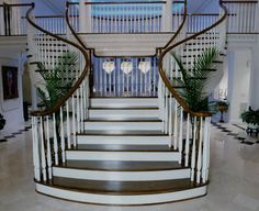 This gorgeous double curved staircase starts as two, then forms into one! A stunning first impression for all house guests. Made By Southern Staircase. Visit our website: www.southernstaircase.com.