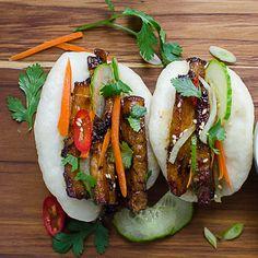 Bulgogi Pork Belly Bao on a wood board. Korean Pork Belly, Pork Belly Bao, Vietnamese Recipes, Asian Recipes, Ethnic Recipes, Hawaiian Recipes, Japanese Recipes, Vietnamese Food, Chinese Recipes