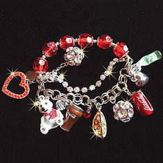 Coca Cola Charm Bracelet - Iconic Coca Cola symbols dangle from this unique collectible!