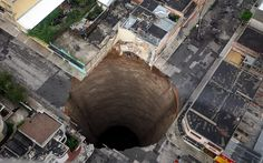 The 2010 Guatemala City sinkhole was a disaster in which an area approximately 65 ft (20 m) across and 300 ft (90 m) deep collapsed in Guatemala City's Zona 2, swallowing a three-story factory. The sinkhole occurred for a combination of reasons, including Tropical Storm Agatha, the Pacaya Volcano eruption, and leakage from sewer pipes.