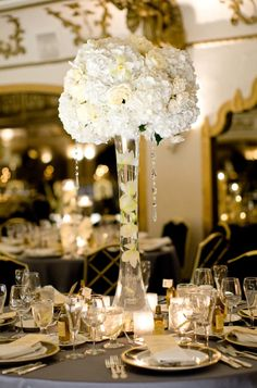 Tall vases + White hydrangeas (or other flowers) + Candles = great reception centerpieces