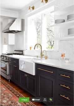 From Houzz - Wood floor, darker lower cabinets, white upper cabinets, brass hardware