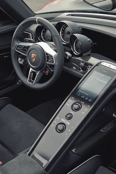 Porsche 918 Spyder black steering wheel interior race sport digital dashboard multifunction button interface
