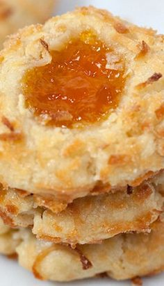 Tasty }- Coconut Thumbprint Cookies - These are basically plain buttery shortbread cookies that have been rolled in sweet coconut and topped with a dollop of really great pineapple-apricot preserves. Cookie Desserts, Just Desserts, Cookie Recipes, Delicious Desserts, Dessert Recipes, Yummy Food, Cupcake Recipes, Cookies Receta, Yummy Cookies