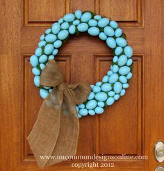 this would make such a cute easter wreath. change up the blue eggs with some more easter colors. cute :)