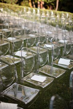The transparent nature of the ghost chair works fabulously for the outdoor ceremony