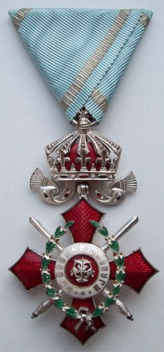 Note way ribbon is folded. Medal of Military Merit 5th Cl with Crown & Swords on War Ribbon