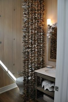 ...Pieces of driftwood, drilled, strung on fishing line. Imagine how that smells after a few days with the door closed.