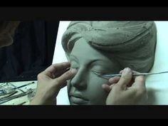 Sculpting a beautiful female face in wet clay. Demo and tutorial how to sculpt girl face in clay . In this short sculpting demo you will see technique of scu.